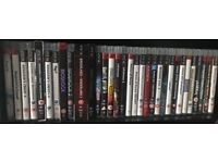 1TB Sony PlayStation 3 & 32 Games & 2 Guitar Hero controllers
