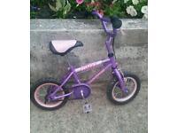Girls beautiful purple miss universal bike 12 inches wheel in good condition