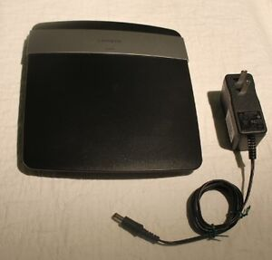 Linksys E2500 wireless router / Hon-Kwang power supply