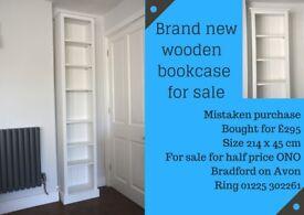 Brand new white painted wooden bookshelf; bought in error so brand new.
