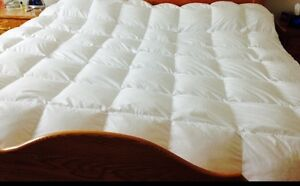 Homemade Hutterite goose down and feather duvets.