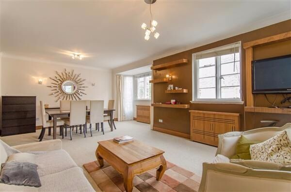 A stylish three bedroom flat situated on the third floor (with lift) of a portered mansion block.