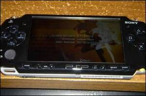 PSP 2001 w/ 8 gb memory + custom firmware mm3 and case