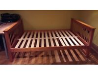 Solid wood honey pine double bed with drawers.