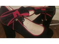 Brand new Black and pink heels with bow