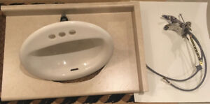 countertop, sink, faucet, soap dish, paper dispenser & towel bar