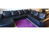 Corner sofa, black leather for sale