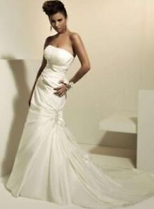 Two brand new wedding gowns