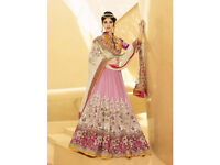 Hypnotizing Cream and Pink Net Designer Lehenga Choli