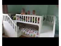 Custom made bunk beds with slide and storage