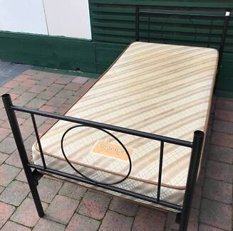 Excellent metal frame single bed set for sale. Delivery available