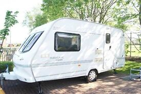 Elddis Hurricane EX2000 2 berth caravan with full size and porch awnings and extras - ready to go