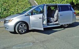 2014 silver Honda Odyssey on lease till May 2019