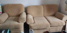 Two seater sofa and matching chair.
