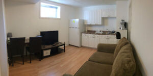 Furnished two bedrooms basement suite with a separate entrance