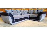Corner sofa - grey & black. Can deliver