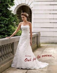 Robe de marié en dentelle. Elle est de couleur ivoire. Elle a ét