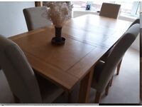 Oak extending dining table & 6 beige fabric chairs Housing Units