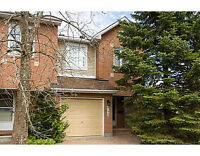 END UNIT TOWNHOME WITH GARAGE AND LARGE BACKYARD