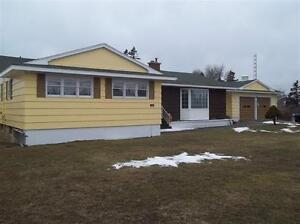 large 4 bedroom retro bungalo with attached 2 car garage