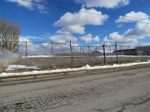 Large 2 Acre Paved Fenced Parking Lot For Rent