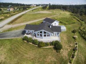 New Price  Beautiful home in a great location with a ocean  view