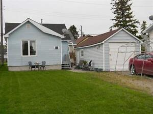 CHEAPER THEN RENT 2+1 BDRM HOME WITH A GARAGE