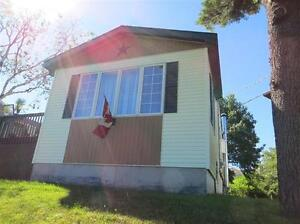 Price Reduced Home w. Zoned R2 Lot for Future Development