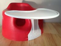 Red Bumbo chair with tray