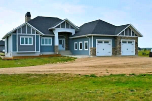 Acreage only 10 min from Saskatoon. Motivated to sell!