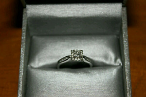 0.5 CT White gold engagement ring, size 7