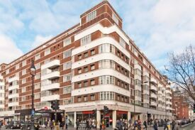 Super spacious and bright studio apartment on Tottenham Court Road opposite tube station