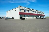 Commercial bays with retail store front and office Stony Plain