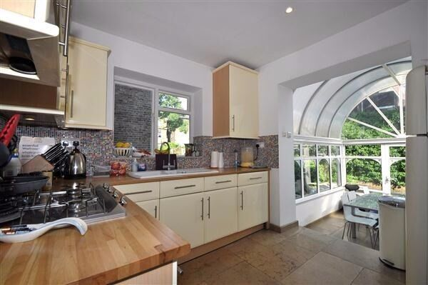 Spacious flat beautiful decor throughout and boasting a large conservatory and private garden.