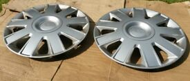 Ford hub caps wheel trims £7.50 ono for a pair of 15 inch spares.Genuine Parts. Excellent condition.