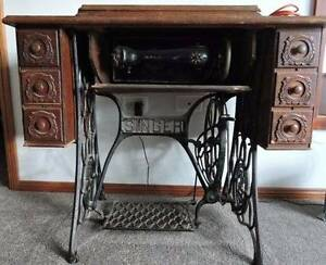 Singer Treadle Sewing Machine in metal and carved timber cabinet Hornsby Hornsby Area Preview