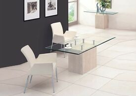 Beautiful glass and marble dining room table with six cream chairs