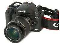 Canon 500D, with case, strap, and battery charger.