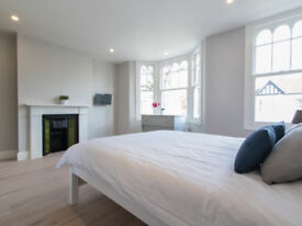 A room within this six bedroom house refurbished to the highest standard in West Ealing