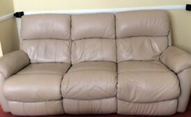 Three seater leather electric reclining sofa.