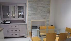 Spacious modern home office with desk spaces for hire during the day in Cambridge
