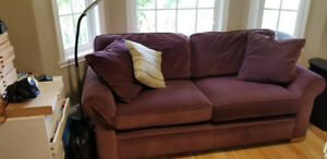 Plum colored apartment sized sofa and char.