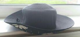 Ladies black hat with unusual print detail underneath