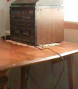 hardwood table with two leaves.