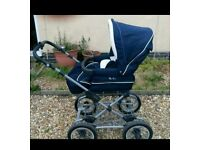 Sliver cross pushchair can turn into a pram