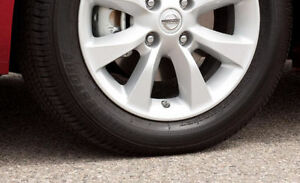 2012 Sentra SL 4 bolt rims with almost new all season tires (x4) London Ontario image 1