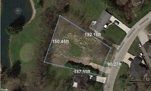 HALF ACRE LOT OFFERING 150 FEET ALONG ROSELAND GOLF COURSE!