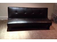 Chocolate faux leather sofa bed.