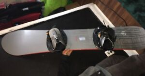Snowboard for sale, never used, was bought and stored away