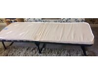 Almost new fold away single bed